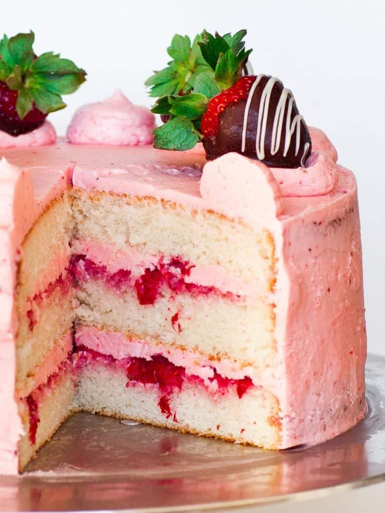 inside slice of strawberry champagne cake with strawberry buttercream