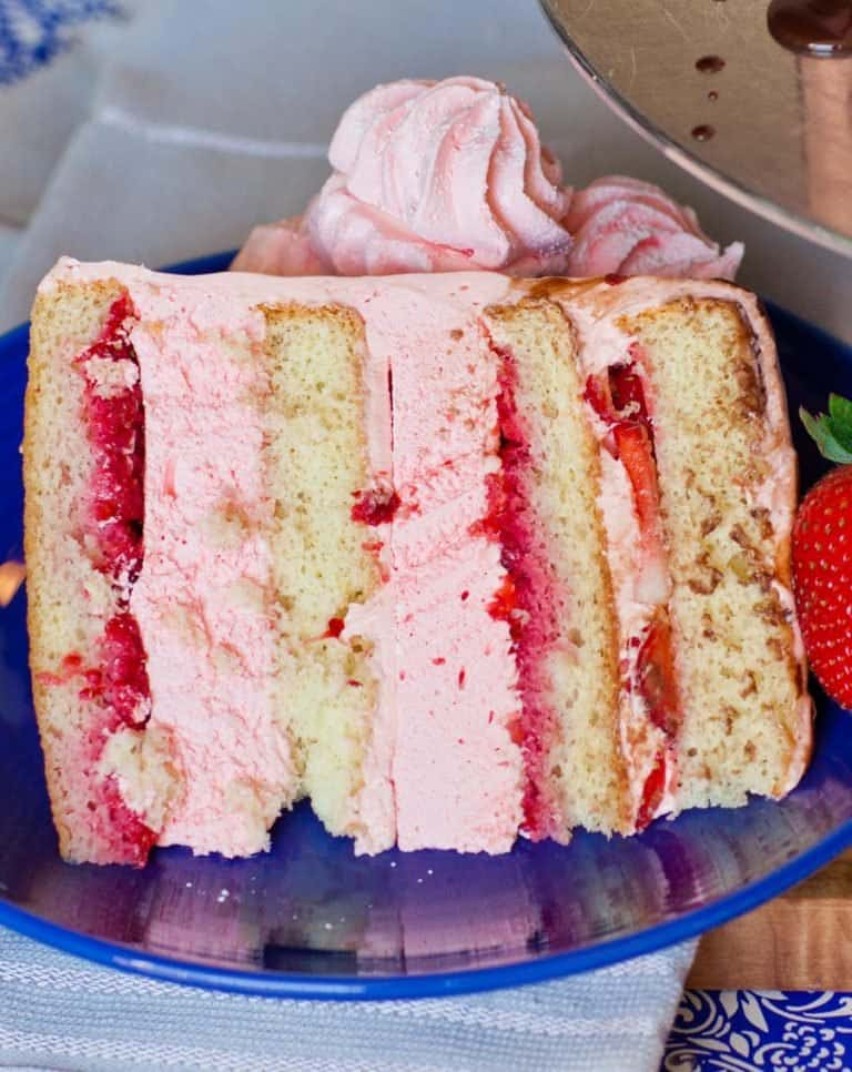 slice of strawberry marshmallow cake with fresh strawberry filling