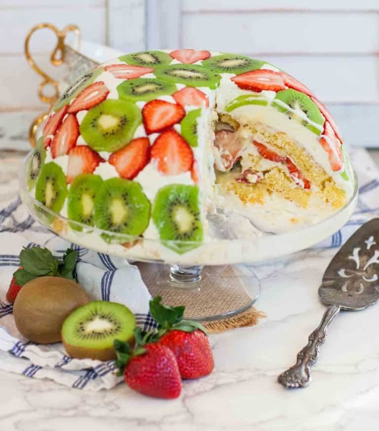 sliced trifle cake with fruit and pastry cream