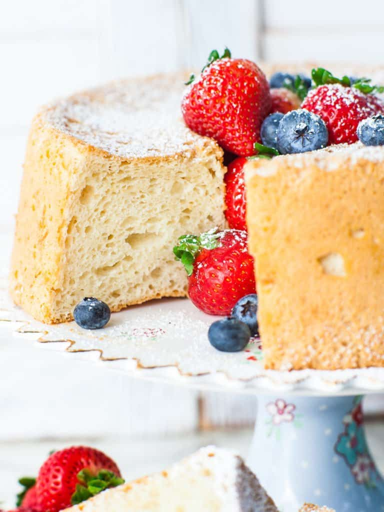 video tutorial for how to make angel food cake; sponge cake on a floral cake stand