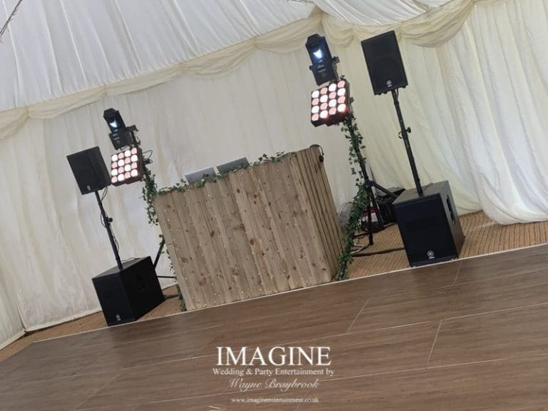 Rustic booth in a marquee setting