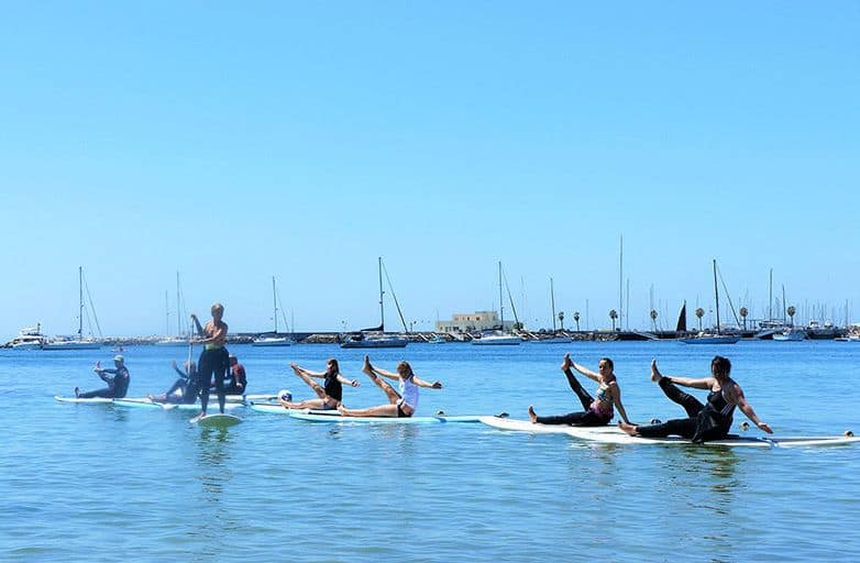 yoga with stand up paddle board