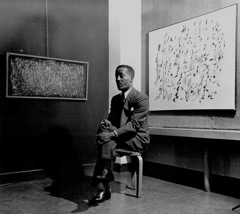 Norman Lewis with his abstract art, ca. 1950