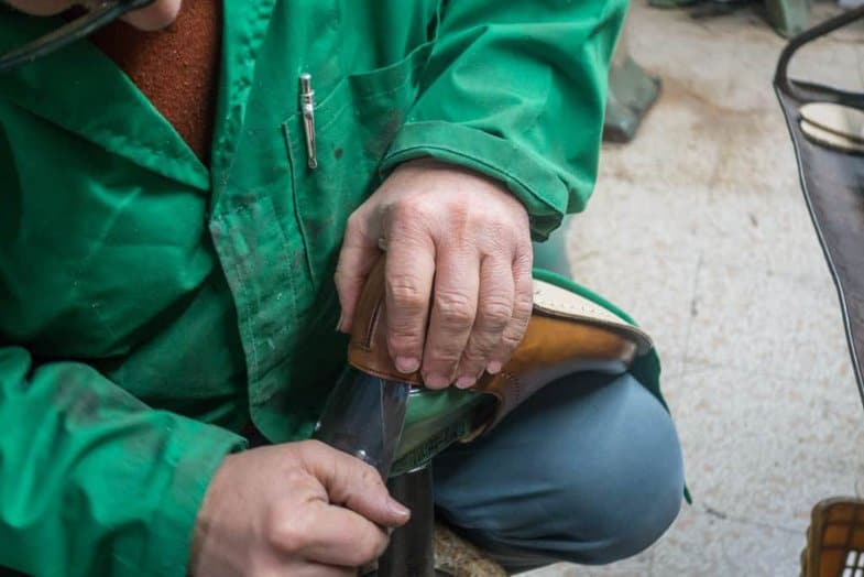 With sort of a professional version of a shoehorn the lasts are put back in the shoes for the rest of the making.