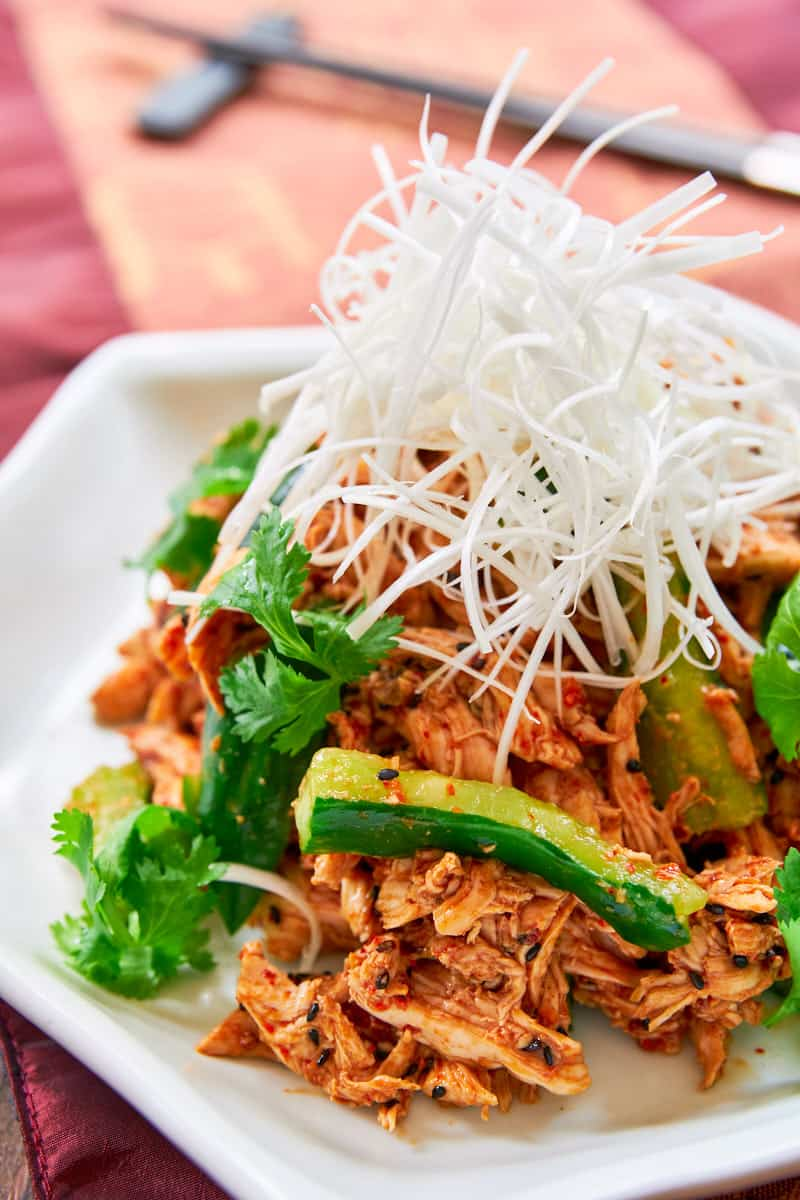 With tender poached and shredded chicken in a spicy sesame chili sauce, this Bang Bang Chicken is a mouthwatering chicken salad that's perfect for summer.
