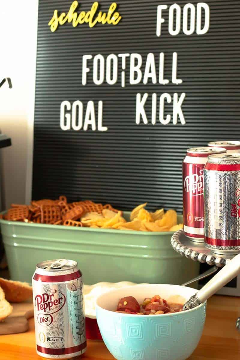Letterboard with words Schedule Food Football Goal Kick and food for homegating party including sausage and bean soup