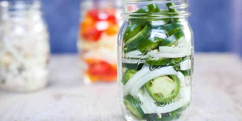 quick pickled jalapeno in a ball mason jar