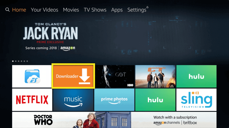 Amazon Fire TV screen with Downloader button highlighted.
