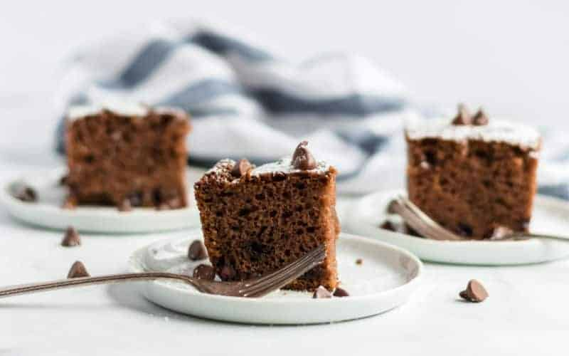 three pieces of chocolate chip cake on white plates