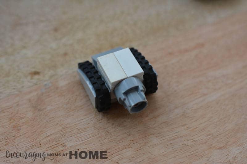 A white mini Lego tank squares off.