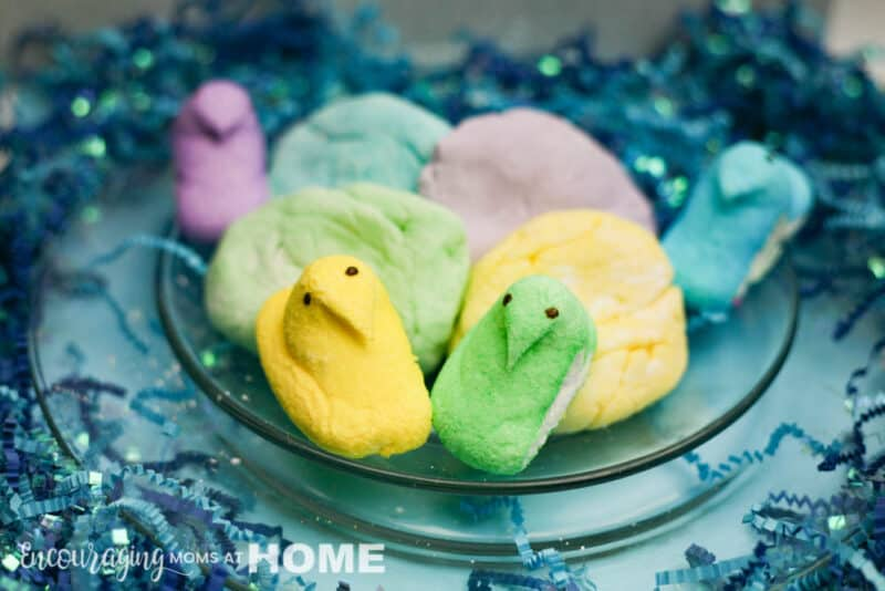 (how to make) Edible homemade playdough out of peeps. Peeps and playdough displayed on a plate with blue confetti.