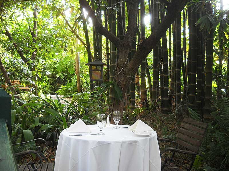Things to do in Delray Beach: Restaurant tables situated in the gardens at the historic Sundy House in Delray Beach. The historic inn is a popular place for Sunday brunch, dinners and, at this table, marriage proposals. (Photo: Bonnie Gross)