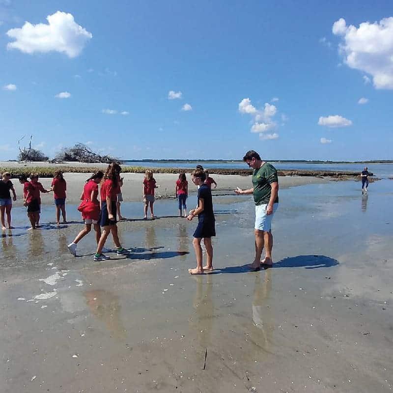 Kids exploring the beach. Nature boat tours Charleston