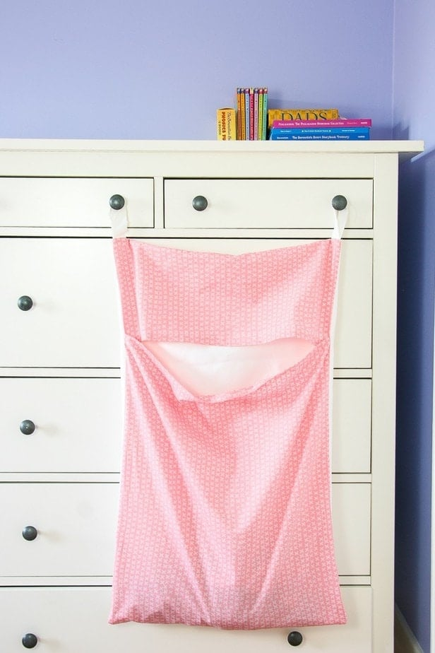DIY : Make your Own Hanging Laundry Bag! This easy diy will give you a sturdy hanging hamper that's easy for kids to actually start using! Pin me or click through for the tutorial.