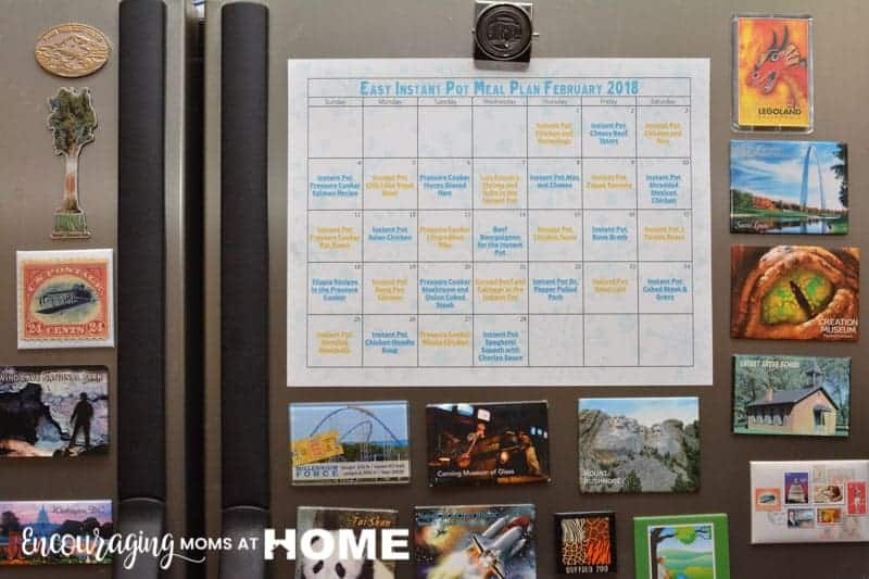 Easy Instant Pot Meal Plan for February hanging on refrigerator