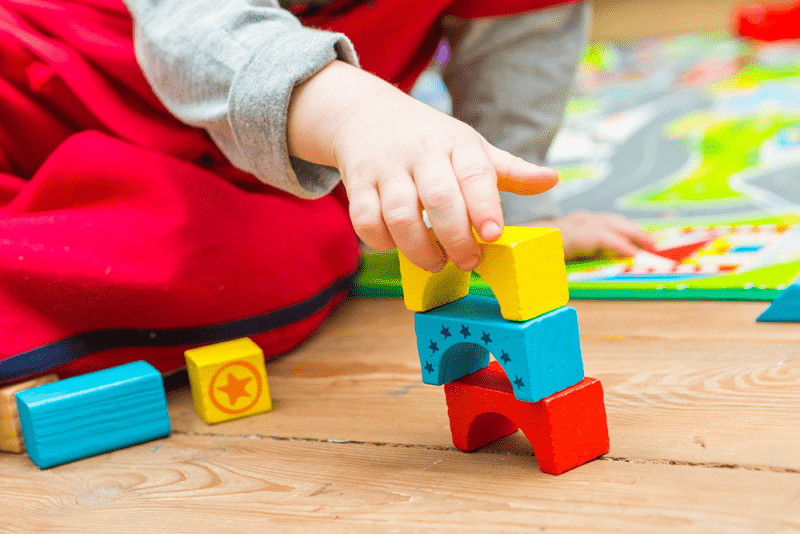 Child playing with blocks in preschool.