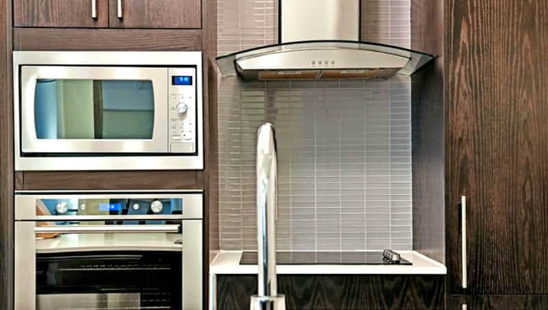 How to clean your stove hood filter - Stainless steel appliances and dark wood kitchen cabinets