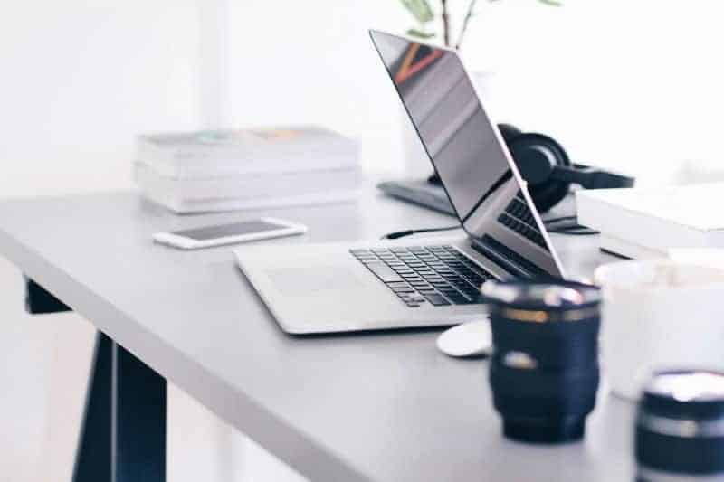 Organizing paperwork and the home office - laptop and iPhone on a clean desk