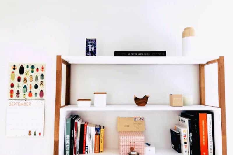 Organizing Tips to Keep Clutter Away - Organized shelves and a wall calendar that says September