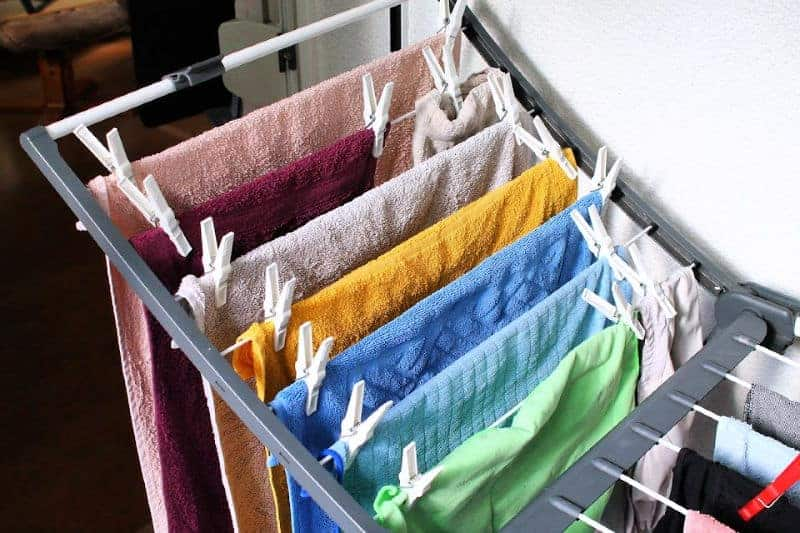 Organizing the Laundry Room - A collapsible drying rack makes efficient use of space