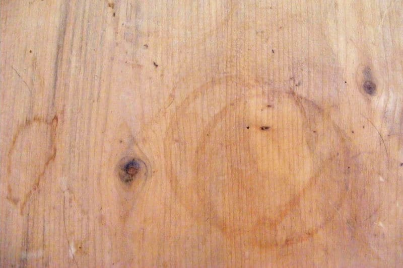 Water rings on wood coffee table that has not been finished