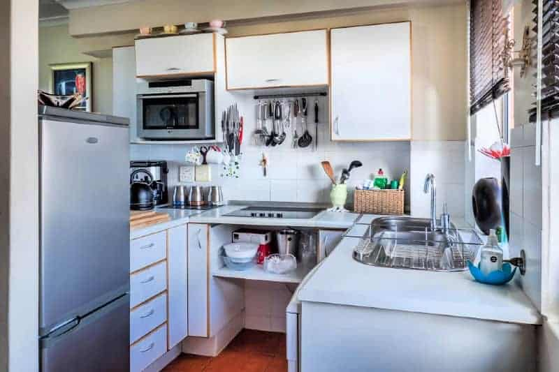 Organized kitchen using vertical space to hold gadgets