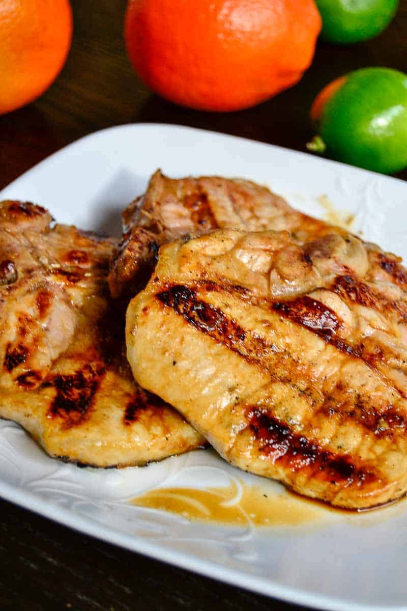Tender, tangy, and subtly sweet, these marinated citrus glazed pork chops are a great solution for your weeknight dinner dilemma.