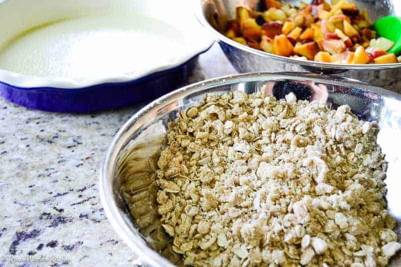 Bourbon Peach Crisp: streusel topping, sliced peaches, and a pie pan