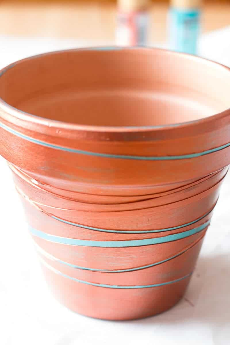 Painted clay pot with rubber bands