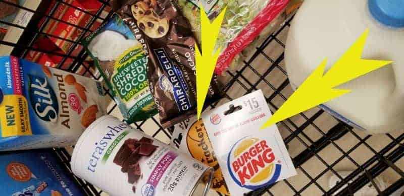 Grocery shopping cart with ingredients for Chocolate Chip Cookie Dough Protein Bites and Gift Cards for eating while traveling