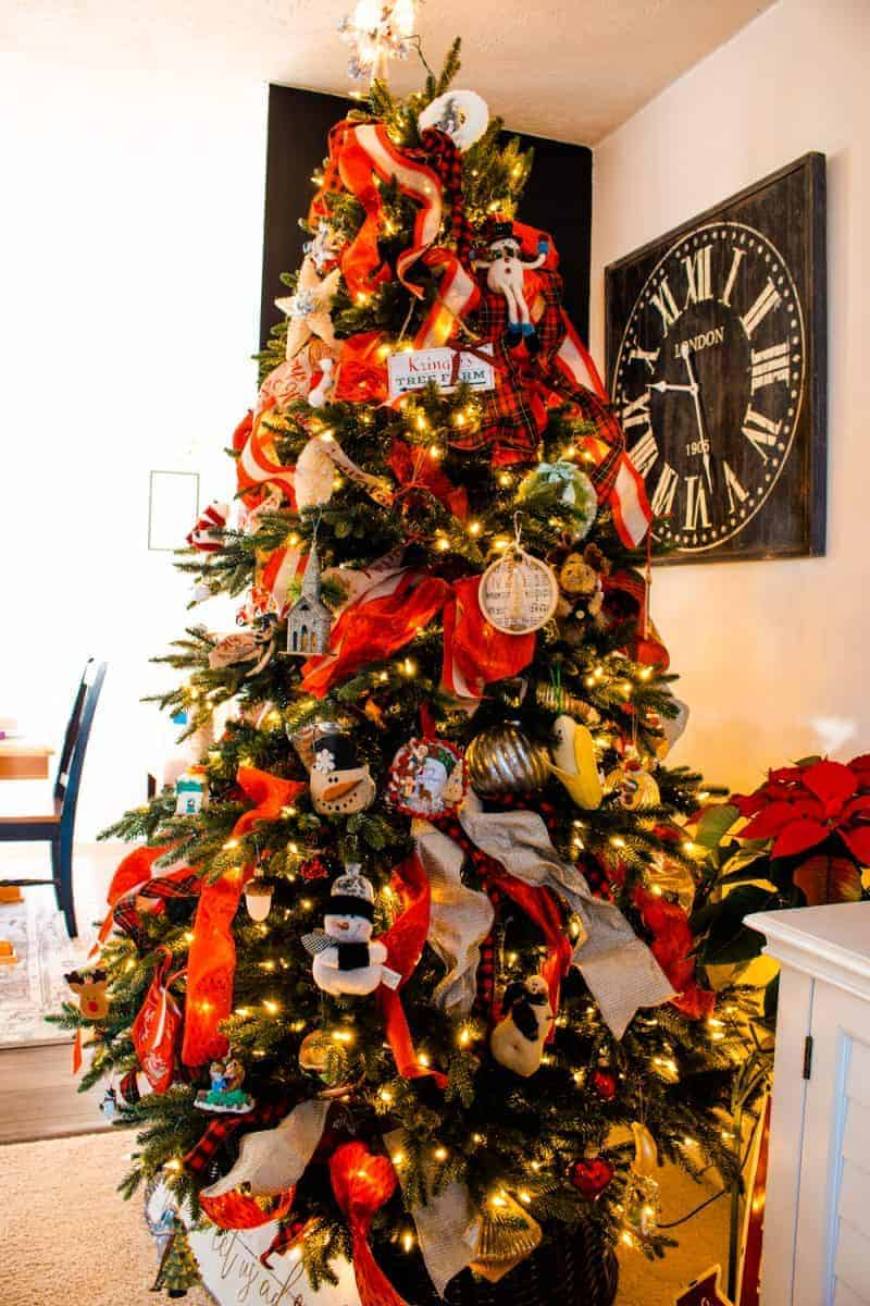 Christmas tree decorated with ribbon and simple ornaments for a farmhouse look