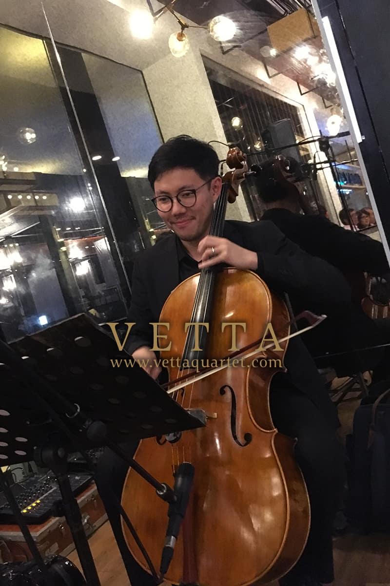 Live String Quartet Cellist providing background music at wedding at Vineyard, Hortpark