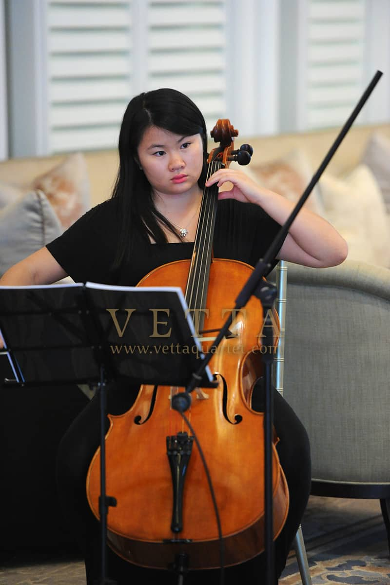 Female String Quartet Cellist playing graceful music for corporate celebration at Clifford Pier