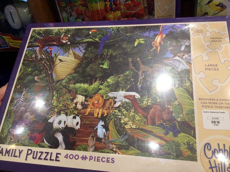 family puzzle zoo scene with different size pieces at wings of the wind
