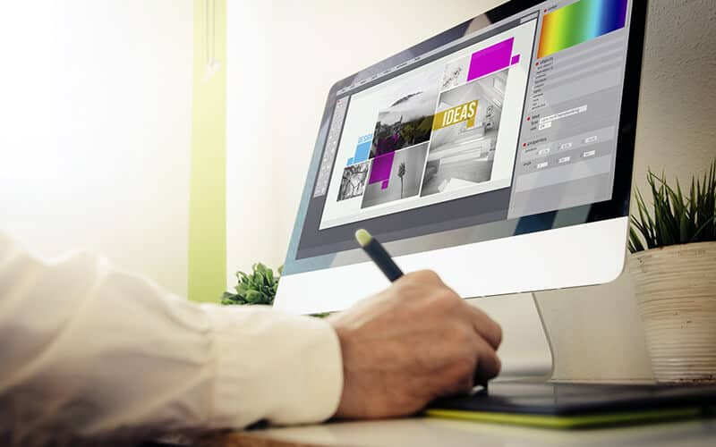 A Designer Using A Computer
