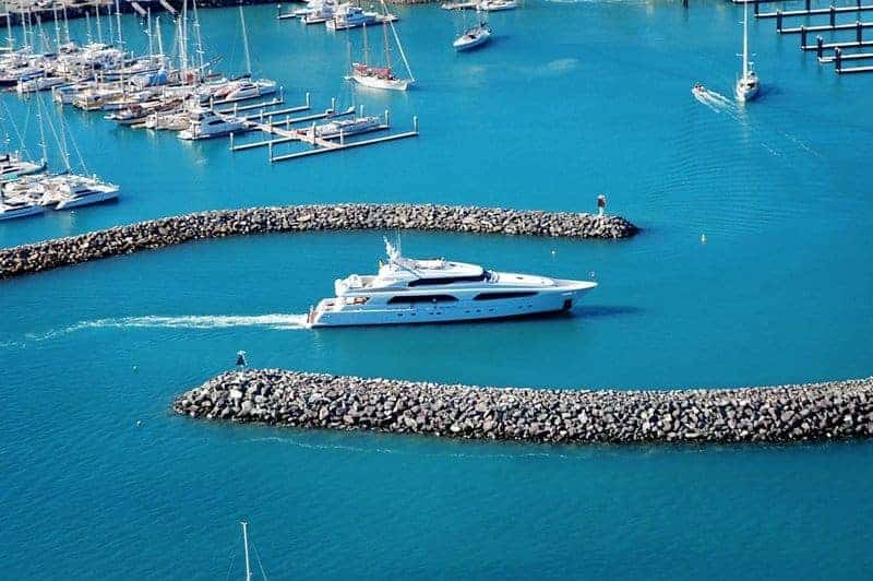 A superyacht entering Coral Sea Marina
