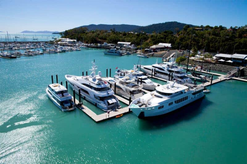 aerial of private superyacht arm and superyachts at Coral Sea Marina