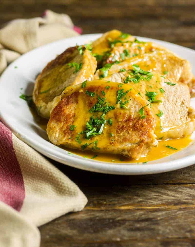 These delectable Instant Pot Pork Chops are from my first cookbook, <a href=