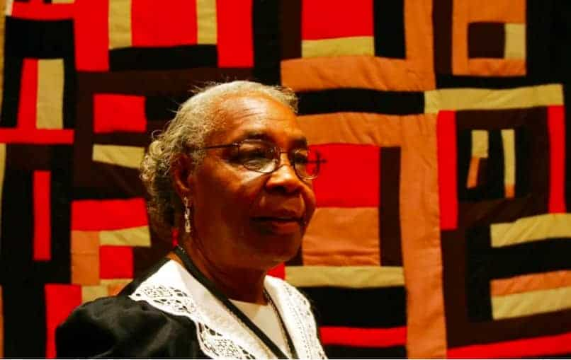 Mary Lee Bendolph in front of one of her quilts