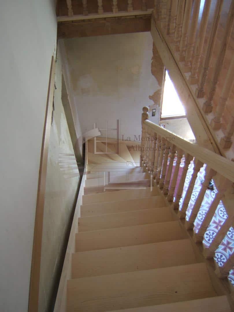 Escalier en bois à quart-tournant