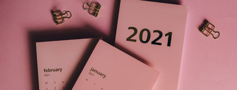 2021 calendars and clips on pink table