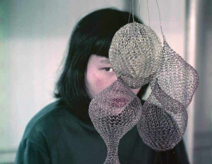 A photograph of Ruth Asawa and her art taken by her close friend Imogen Cunningham circa 1957. Photograph © Imogen Cunningham Trust and Estate of Ruth Asawa/David Zwirner Gallery