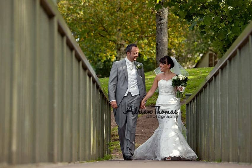 Caerphilly Castle moat bridge with bride and groom during Caerphilly Wedding