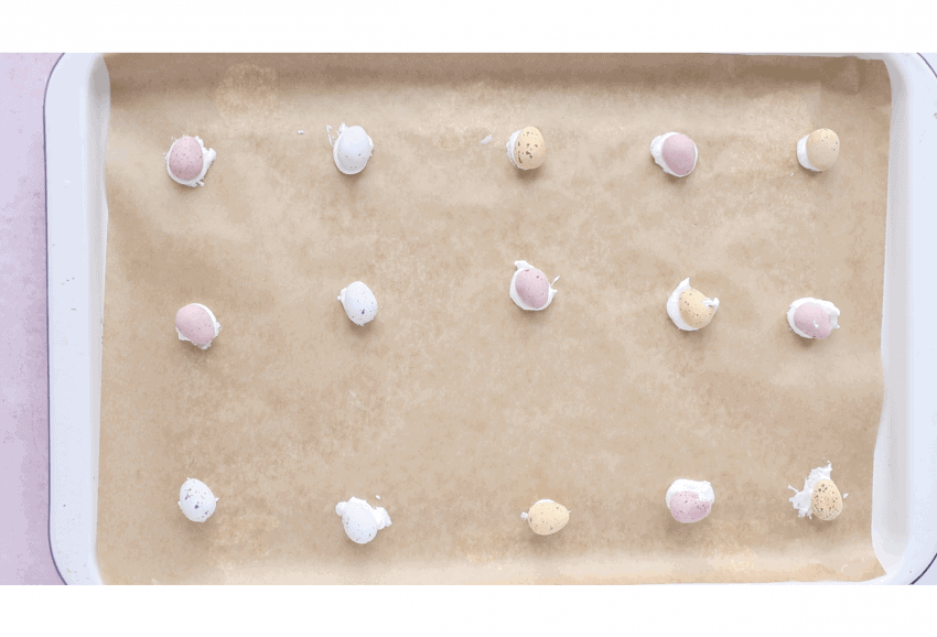 mini eggs stuck to a baking tray using meringue mixture