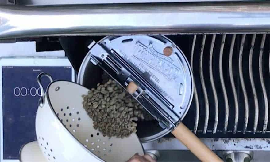 Pouring green coffee beans into a Whirley Pop
