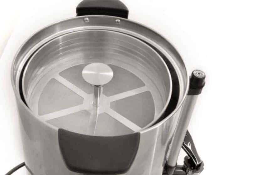 A view inside the lid of a large coffee percolator
