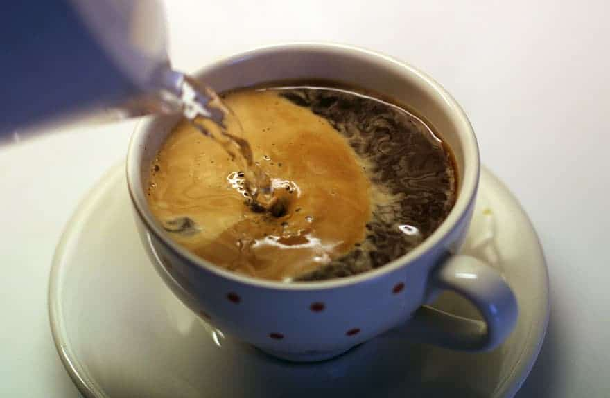 Pouring water into an Americano