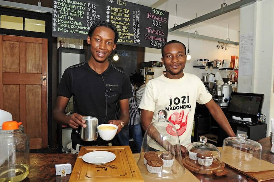Smiling baristas behind the counter