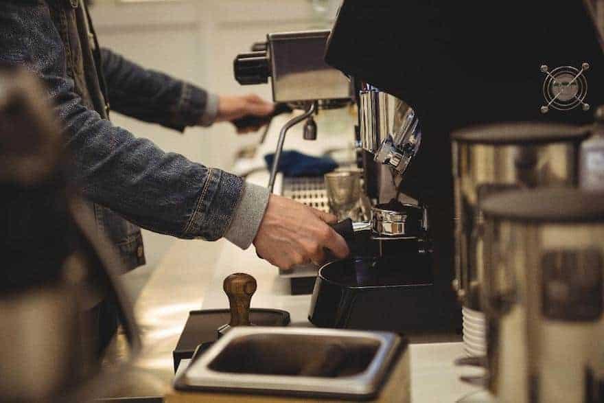 Barista prepares to brew an espresso