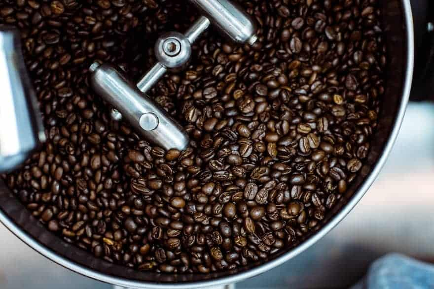 Dark roast coffee in a cooling tray at the roaster